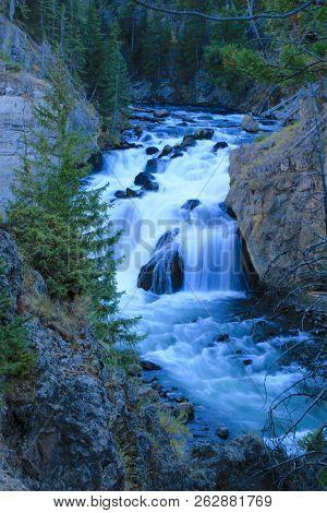 Beautiful Waterfall Running Through Yellowstone National Park