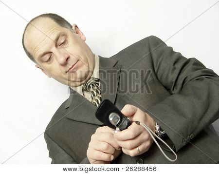 Businessman making a call on a cellular phone with calm face isolated on white background