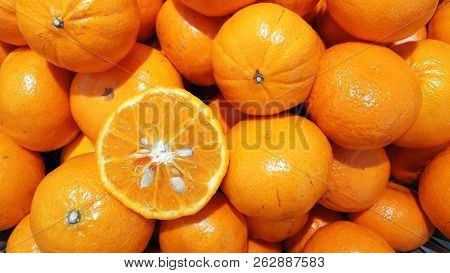 Fresh Oranges, Oranges Background, Bunch Of Fresh Organic Oranges. Big Bunch Of Ripe Tangerines.