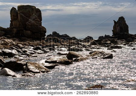 Gloomy and dark rocky coastline of the Ushant island, Brittany, France