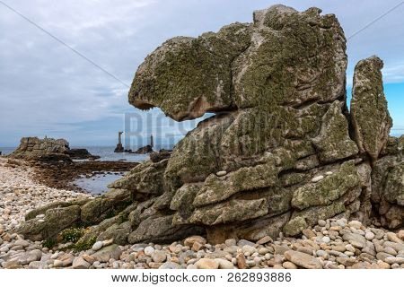 Strange shaped rock and Nividic lighthouse in Ushant island, Brittany, France