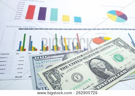Us Dollar Banknotes Money On Chart Graph Spreadsheet Paper. Financial Development, Banking Account,