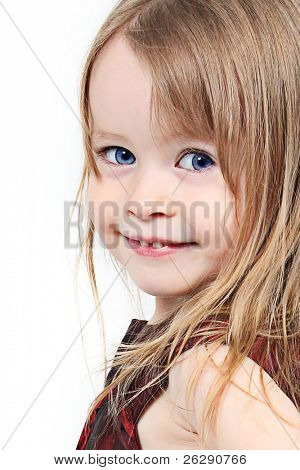 Pretty little girl taken closeup with blue eyes