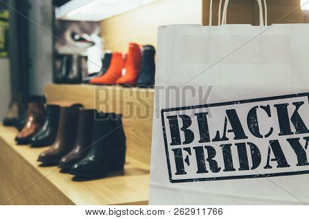 Black Friday. Close Up Of A Cropped View Of A Shopping Bag Printed With Black Friday Text In A Shoe