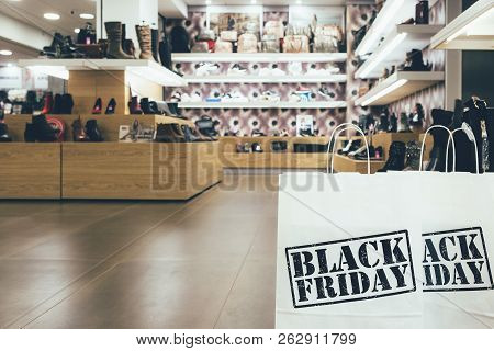 Black Friday. Close Up Of Shopping Bags Printed With Black Friday Text In A Shoe Store.