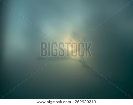 Dramatic Background Of Blue-green Tonality. Fig Leaves On A Branch Silhouette Aspiring To The Sun. A