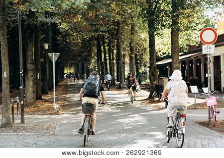 Germany, Muenster, October 5, 2018: People Ride Bicycles Along The Bike Path. Everyday City Life