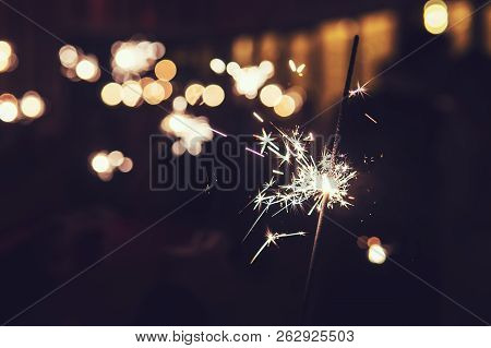 Beautiful Sparkler Firework Flame On Black Background. Bright Bengal Lights Spark In The Darkness. N