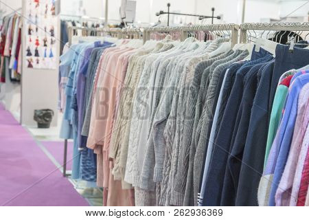 Warm Winter Demi Raglans On White Shopping Racks With Silver Metal Parts On Clothes Shop. Bright Dif