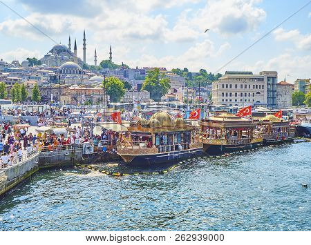 Istanbul, Turkey - July 11, 2018. The Fish Sandwich Boats Moored In Eminonu Pier At The Mouth Of The