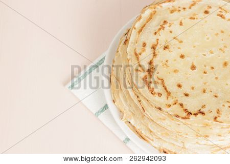 Pancakes On A Saucer On A Kitchen Towel. Many  Flapjack Are Stacked. Thin Pancakes With Crispy Crust