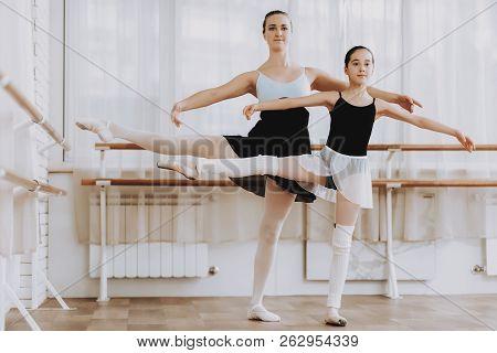 Ballet Training Of Little Girl With Teacher Indoor. Classical Ballet. Girl In Balerina Tutu. Trainin