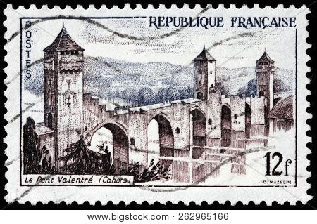 Luga, Russia - September 12, 2018: A Stamp Printed By France Shows The Pont Valentre - A Six-span Fo