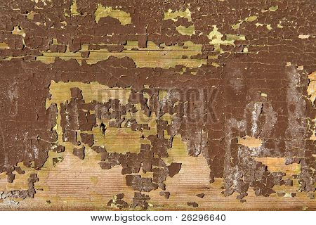 Grungy background texture of wood with paint falling apart