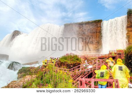 Poncho Clad Tourists Walk On The Wooden Stairs Leading To The Bridal Veil Falls, An Offshoot Of Amer