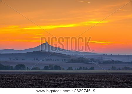 The Silhouette Of Hazmburk Castle At Sunrise.central Bohemian Uplands,czech Republic. At The Top Of