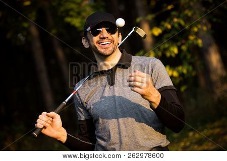 Portrait Of Cheerful Smiling Playful Golfer Or Golf Player.