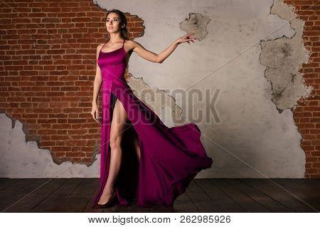 Model In Elegant Dress, Woman Posing In Flying Silk Cloth Waving On Wind, Beauty Fashion Portrait Ne