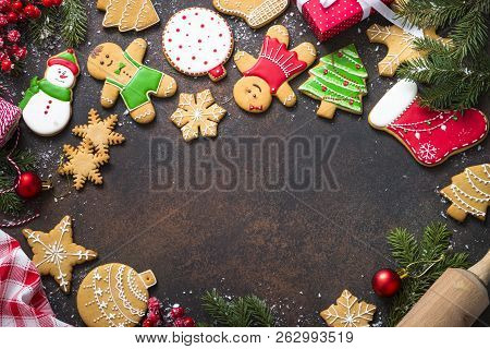 Christmas Gingerbread With Christmas Decorations On Dark Stone Background. Christmas Baking Backgrou