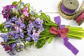 Colorful bouquet with spring wild  hyacints and another meadow flowers on white poster