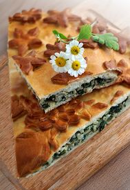 Fresh Baked Traditional  Pie With Green Onions And Eggs On A Wood Table