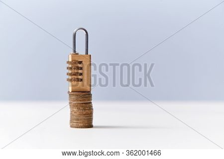 Combination Padlock On Stack Of Coins, Copy Space. Account Lock. Freeze Financial Operations, Conduc