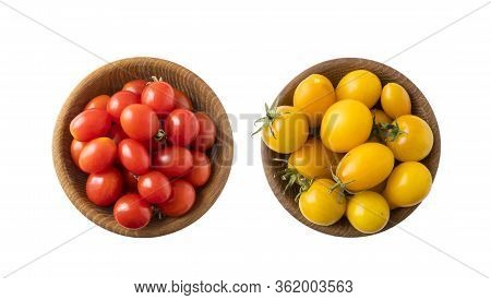 Red And Yellow Tomatoes Lay On White Background. Top View. Cherry Tomatoes On A Wooden Bowl Isolatio