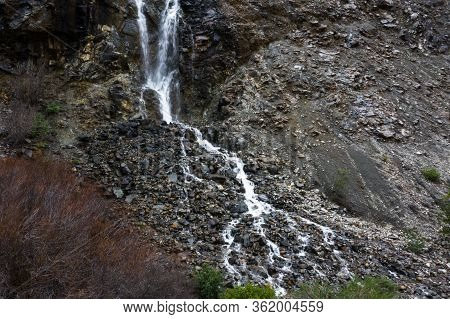 Seasonal Waterfall In A Rocky Hillside