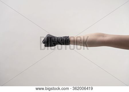 Hands In Black Silicone Gloves On A Light Background.