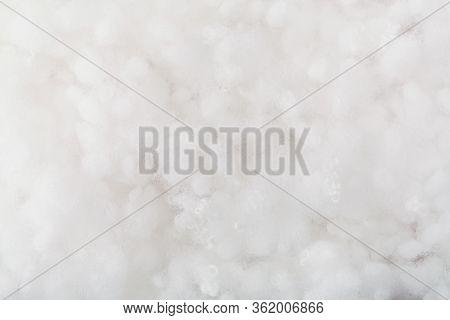 Springy Clean White Hollow Fiber. Holofiber Closeup Texture. Non-woven Synthetic Textile