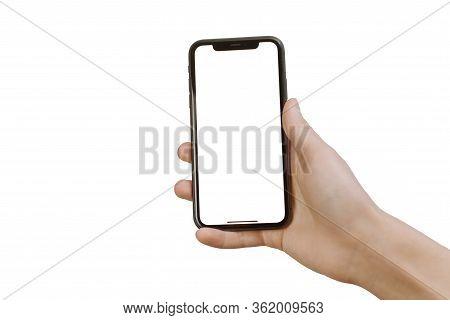 Samara Russia - 04.05.2020: A Young Man Climbs In A Smartphone. Smartphone Mockup. Business Hand Hol
