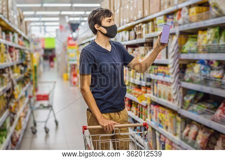 Alarmed Man Wears Medical Mask Against Coronavirus While Grocery Shopping In Supermarket Or Store- H