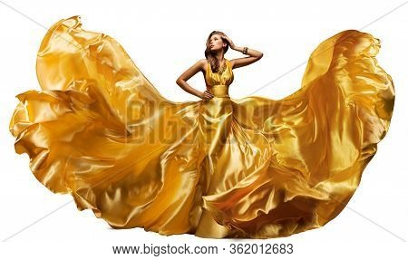 Woman In Fluttering Gold Dress On White, Waving Silk Cloth, Artistic Fashion Model In Golden Color F
