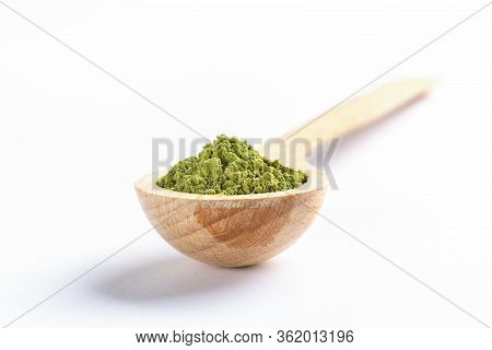 Wooden Spoon Full Of Green Japanese Matcha Tea Powder On White Background. Matcha Tea Is Natural Org