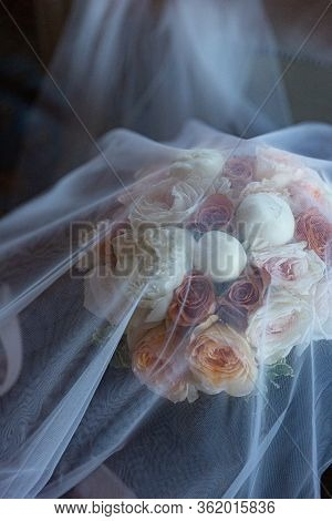 Beautiful Wedding Bouquet For Bride In Nude Colors Covered With Veil