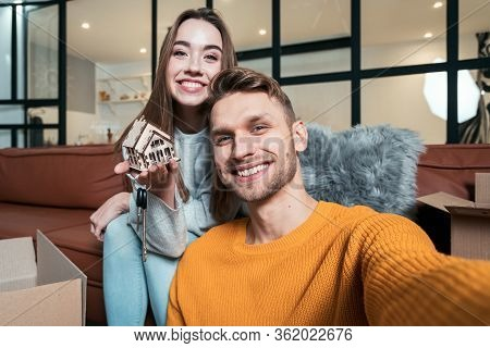 Relocation Concept. Cheerful And Happy Young Adult Man With Woman Move In New Accommodation Together