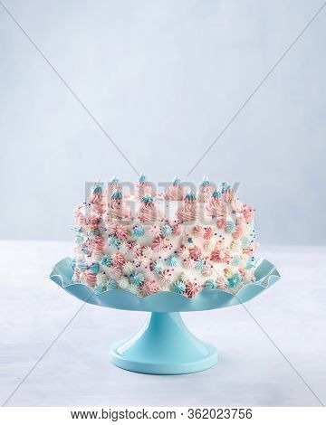 Colorful Buttercream Birthday Cake Decorated With Pink Buttercream Swirls Over A Blue Background. Sp
