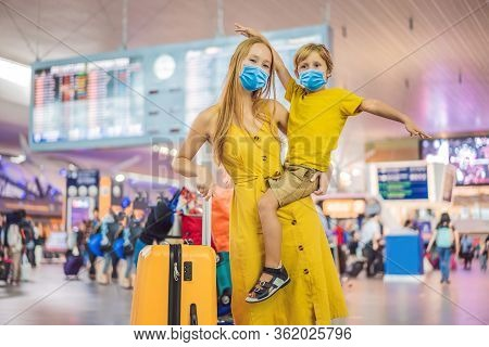 Family At Airport Before Flight. Mother And Son In Medical Mask Waiting To Board At Departure Gate O