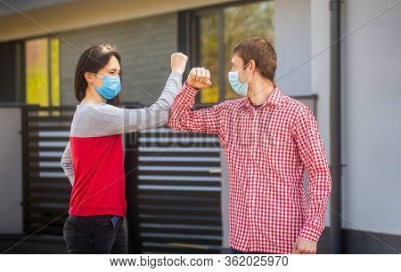 Elbows Bump. Friends In Protective Medical Mask On His Face Greet Their Elbows In Quarantine. Elbow