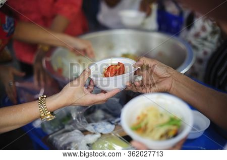 Volunteers Share Food To The Poor To Relieve Hunger : Charity Concept : Donate Food To Hungry People