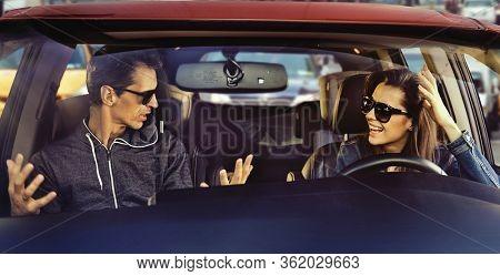 Smiling copule talking in a car