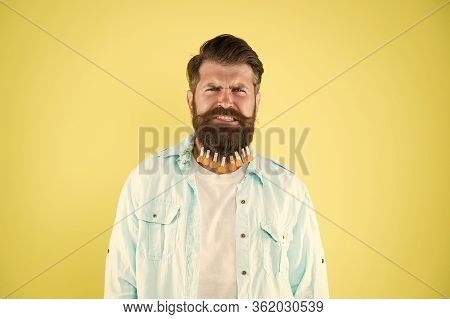 It Hurts So Much. Individual Hairstyle For Male. Man Clothespin On Beard. Brutal Hipster With Clothe