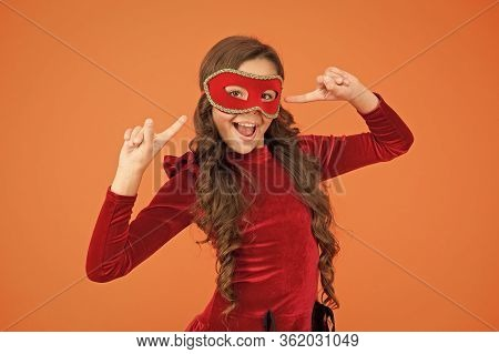 Express Yourself With Your Festive Accessory. Happy Child Point At Eye Mask Accessory. Little Girl W