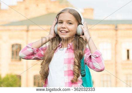 Educational Podcast. Kid Girl Enjoy Music. Pleasant Time. Child Headphones Listen Music. Audio Book