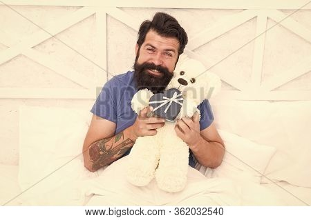 Make Surprise Concept. Gift For Spouse. Cute And Romantic Gift. Bearded Hipster Prepare Lovely Gift.