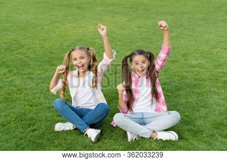 Lets Celebrate. Happy Kids Make Winner Gestures. Little Children Celebrate On Green Grass. Celebrati