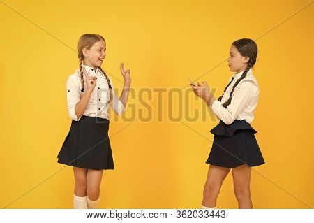 School Application Smartphone. Schoolgirls Use Mobile Phone Or Smartphone To Share Photos. Internet