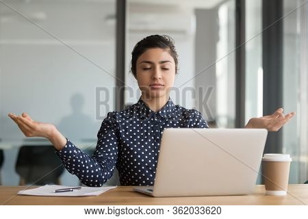 Calm Serene Office Worker Indian Woman Resting Meditating At Workplace