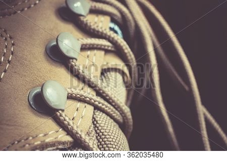 Leather Shoes And Sport Lacing Close Up. Travel Wear Boots Background