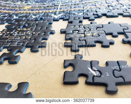 Pieces Of An Incomplete Puzzle Jigsaw On A Brown Background